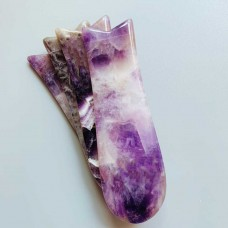 Amethyst gua sha in fish shape